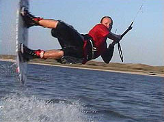 Whipping the wakeboard moves behind a kite, no gas required. Go the Dermist!